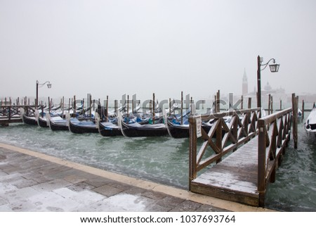 Venice in snow with gondolas on Grand Channel, St. Mark square, snowing in Venice #1037693764