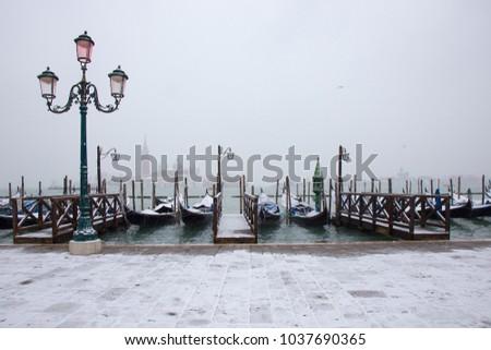 Venice in snow with gondolas on St. Mark square #1037690365