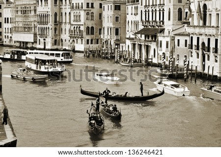 VENICE ITALY APRIL 11 A view of the Grand Canal from Rialto Bridge on April 14 1013 in Venice Italy This main canal is 3800 meter long 30- 90 meters wide with an average depth of five meters
