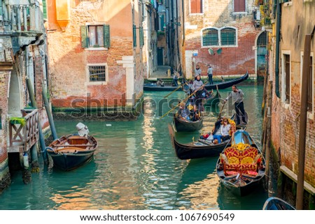 Venice, Italy. April 12, 2018. Beautiful Venice narrow canals, with many classic gondolas, amazing old rusty buildings, near old cathedral of Santa Maria della Salute.  #1067690549