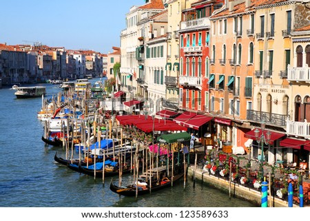 VENICE, ITALY -APRIL 8: Gondolas and tourists on April 8, 2011 in Venice, Italy. Venice has an average of 50,000 tourists a day and was the 26th most visited city in the world.