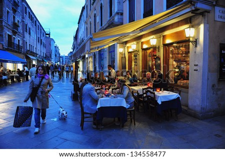 VENICE, ITALY - APRIL 30 2011:People dinning in a restaurant in Venice Italy.Each year the town receives 18 million tourists. This equates to approximately 50,000 visitors each day