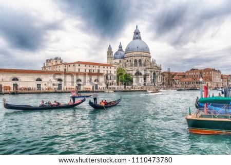 VENICE, ITALY - APRIL 29: The Basilica of Santa Maria della Salute, a Roman Catholic church and iconic landmark located in the Dorsoduro district of Venice, Italy, April 29, 2018 #1110473780