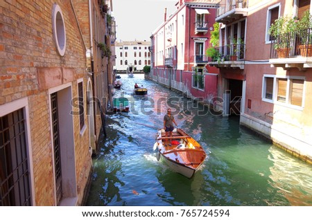 Venice,Italy-August 19,2017:Canals of Venice.Everyday most of tourists take gondola tour in the canals of Venice.The canals are used not only for touristic purposes but also for transportation. #765724594