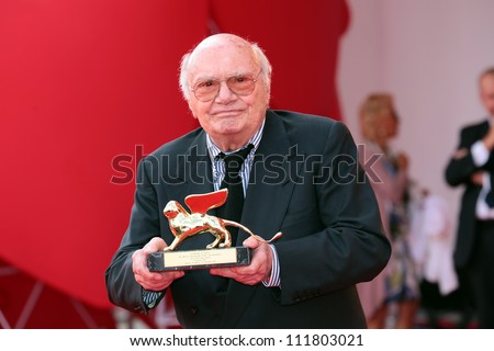 VENICE, ITALY - AUGUST 31:Francesco Rosi poses with his Golden Lion for Lifetime Achievement he received after an award ceremony at the Venice Film Festival on August 31, 2012 in Venice, Italy