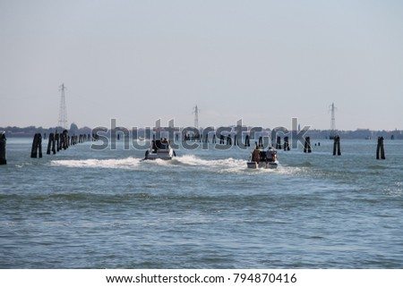 Venice, Italy - August 13, 2016: Motor boats with tourists in the Adriatic Sea #794870416