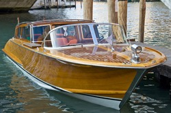 VENICE, ITALY - AUGUST 11, 2012: Wooden motorboat photographed in Venice channels.
