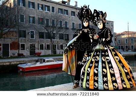 VENICE, ITALY - CIRCA FEB 2007: A couple participate in the parade Piazza San Marco during the Venice Carnival circa February 2007 in Venice, Italy.
