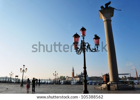 Venice Italy cityscape.The lion of Venice and street lamps in Piazza San Marco - St Mark's Square, Venice Italy.