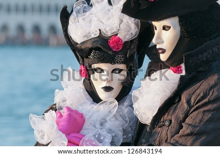 VENICE,ITALY-FEB.12 : Unrecognizable couple wearing carnival costume and posing in Saint George island February 12, 2010 in Venice, Italy. In 2010 the Carnival was held between 11-16 February.