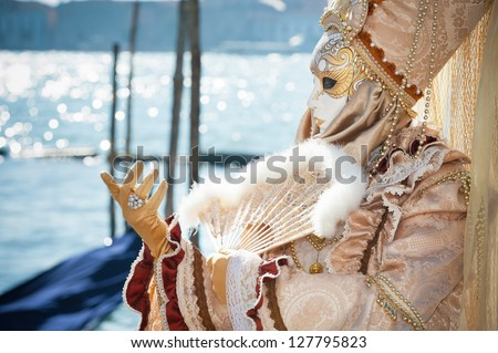 VENICE,ITALY-FEB.17 : Unrecognizable person wearing carnival costume and posing along Saint Mark waterfront on February 17, 2012 in Venice. In 2012 the Carnival was held between 11-21 February.