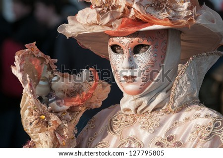 VENICE,ITALY-FEB.12 : Unrecognizable person wearing carnival mask in Saint Mark square on February 12, 2010 in Venice, Italy. In 2010 the Carnival was held between 11-16 February.