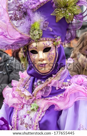 VENICE, ITALY - Februar 27, 2011: Woman in carnival costume is posing on Venice carnival in 2011. Venice is one of the world\'s top places to celebrate carnival.