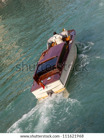 VENICE,ITALY-FEBRUARY 18:A specific water taxi on The Grand Canal in Venice on February 18,2012.Here, the canals serve the function of roads, and almost every form of transport is on water or on foot.