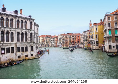 VENICE, ITALY - FEBRUARY 15 : A view of gondolas with tourists sailing through a grand canal next to a Campo Erberia square on February 15th, 2014 in Venice, Italy. #244064158