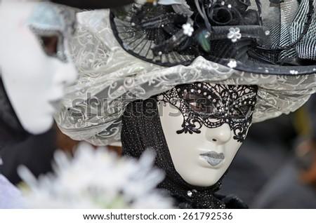 VENICE, ITALY - FEBRUARY 12: black and white carnival masked lady at the 2015 Venice Carnival:  February  12, 2015 in Venice, Italy