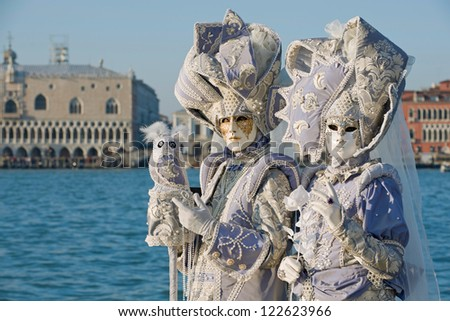 VENICE, ITALY - FEBRUARY, 17: Couple in costume posing at Saint George island, in front of St. Mark's Square during the 2012 Carnival of Venice celebrations, on February 17, 2012.