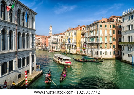 VENICE, ITALY - FEBRUARY 11: Gondolas with tourists in Grand canal on February 11, 2018 in Venice #1029939772