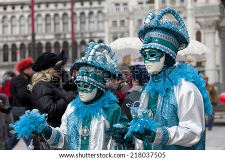 Venice, Italy - February 11, 2012: Two wonderful participant of the annual carnival. Carnival is one of the oldest traditional feasts of Venice.