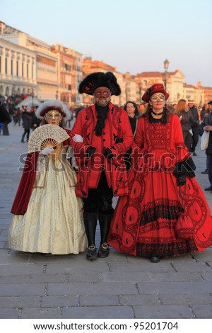VENICE, ITALY-FEBRUARY 26:Unidentified disguised family at St. Mark's Square participate in the Carnival of Venice on February 26, 2011. In 2012 the Carnival will be between February 11- 21.