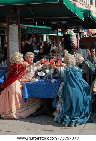 VENICE, ITALY-FEBRUARY 26:Unidentified disguised people celebrate on a terrace at Sestiere Castello during Carnival of Venice on February 26,2011 in Venice, Italy. In 2012 the Carnival will be between February 11- 21.