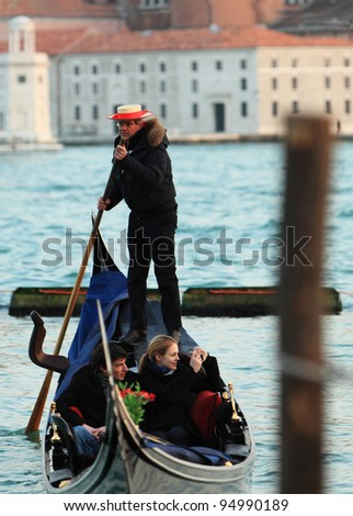 VENICE, ITALY-FEBRUARY 25:Unidentified gondolier sail on a Venetian canal during the Carnival of Venice on February 25, 2011. In 2012 the Carnival is between 11- 21 February.