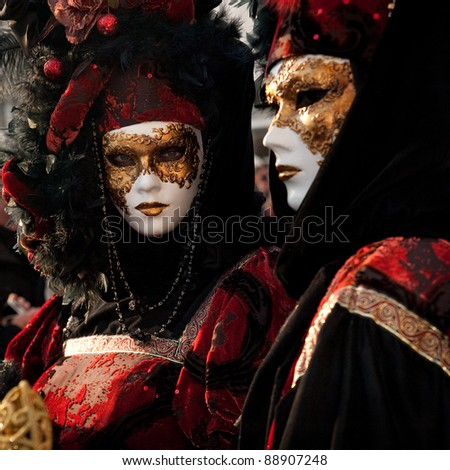 VENICE, ITALY - FEBRUARY 15: Unidentified people in Venetian masks at St. Mark's Square participate in the Carnival of Venice on February 15, 2010. The annual carnival is from February 6 to February 16, 2010.