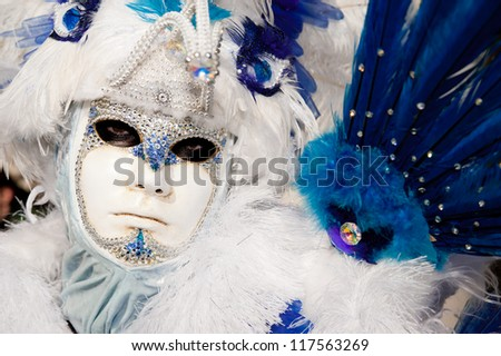 VENICE, ITALY - FEBRUARY 16: Unidentified person in Venetian masks at St. Mark's Square, Carnival of Venice on February 16, 2012. The annual carnival is from February 11 to February 21, 2012.