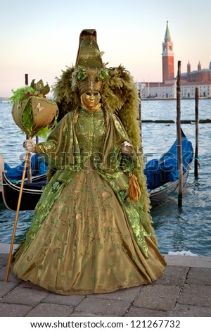 VENICE, ITALY - FEBRUARY 17: Unidentified person in Venice mask at St. Mark's Square, Carnival of Venice on February 17, 2012. Annual carnival was held in 2012 from February 11 to February 21, 2012.