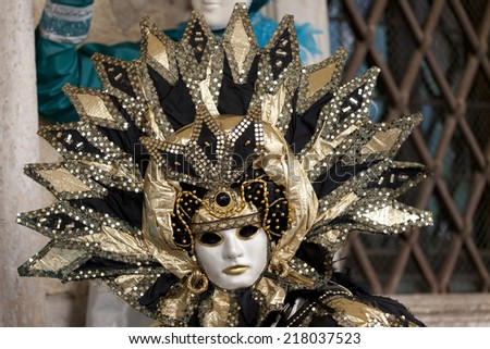 Venice, Italy - February 11 2012: Woman with typical venetian carnival costume at the Carnival of Venice. Shot in St. Mark\'s Square.