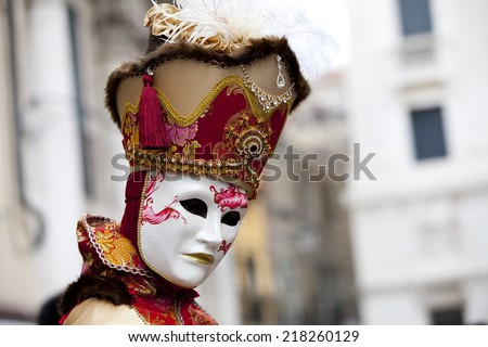 Venice, Italy - February 11 2012: Woman with typical venetian carnival costume at the Carnival of Venice. Shot in St. Mark\'s Square..