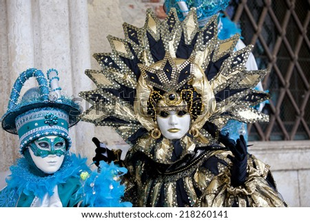 Venice, Italy - February 11 2012: Women with typical venetian carnival costume at the Carnival of Venice. Shot in St. Mark\'s Square..