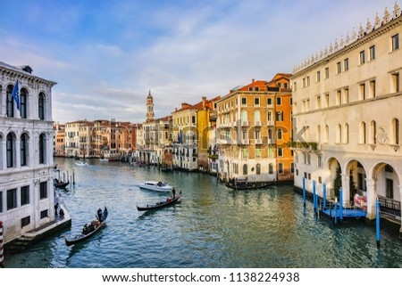 VENICE, ITALY - JANUARY 04, 2018: View of the Grand Canal (Canal Grande) In Venice at sunset. Beautiful ancient architecture and gondolas sailing of the canals. #1138224938