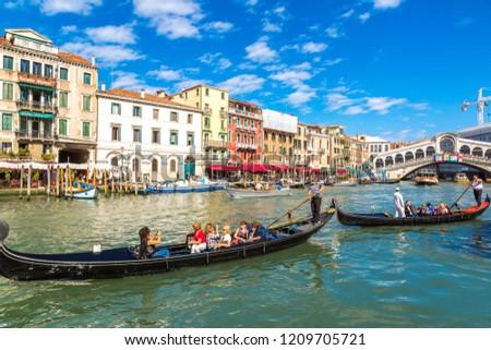 VENICE, ITALY - JUNE 18, 2014: Gondola at the Rialto bridge in Venice, in a beautiful summer day in Italy on June 18 #1209705721