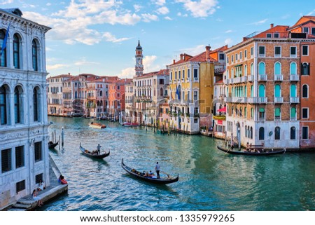 VENICE, ITALY - JUNE 27, 2018: Grand Canal with boats and gondolas on sunset, Venice, Italy #1335979265