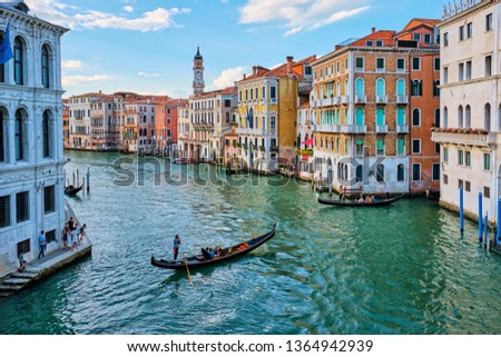 VENICE, ITALY - JUNE 27, 2018: Grand Canal with boats and gondolas on sunset, Venice, Italy #1364942939