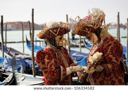 VENICE, ITALY -  MARCH 5: Unidentified couple in carnaval masks at St. Marco Square, Carnival of Venice on March 5, 2011. The annual carnival was held in 2011 from February 26 to March 8, 2011.