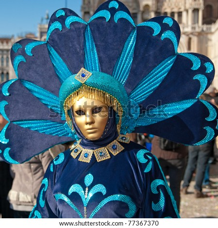 VENICE, ITALY - MARCH 7: Unidentified woman in Venice mask at St. Mark's Square, Carnival of Venice on March 7, 2011. The annual carnival was held in 2011 from February 26 to March 8, 2011.
