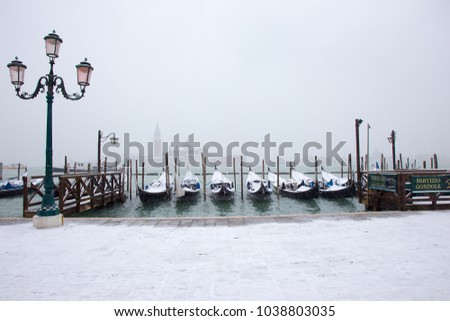 Venice, Italy - March 1, 2018: Venice in snow with gondolas on Grand Channel, St. Mark square, snowing in Venice, Italy, march 2018 #1038803035