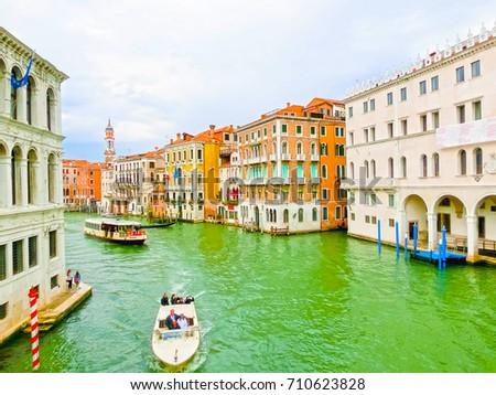 Venice, Italy - May 04, 2017: gondola sails down the channel in Venice, Italy. Gondola is a traditional transport in Venice, Italy #710623828