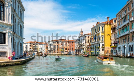 Venice, Italy - May 18, 2017: Grand Canal in the sunlight in Venice. Grand Canal is one of the main travel attractions of Venice. Historical architecture and landscape. Romantic water trip in Venice. #731460901