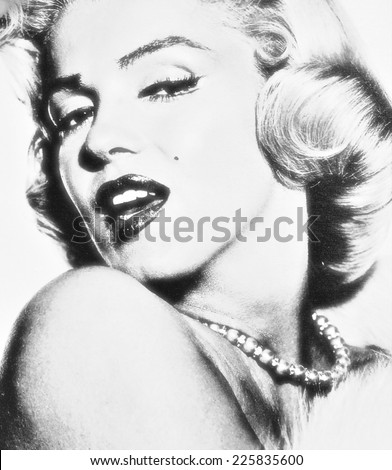 VENICE, ITALY - MAY 6, 2012: Print depicting movie star Marilyn Monroe in famous posing is exhibited in Venetian print shop