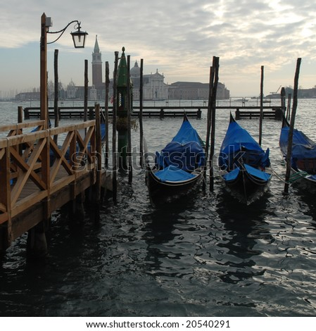 Venice, Italy: Moored gondolas in St.Mark basin during a winter sunset