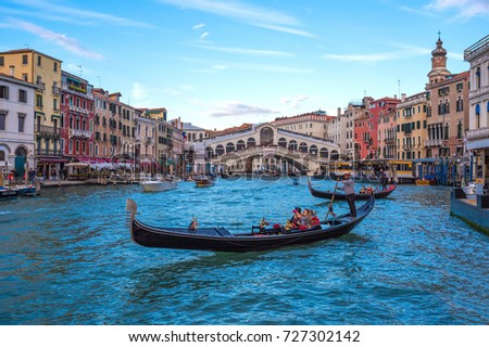 VENICE, ITALY - 21 OCTOBER 2016 - The city on the sea. Here in particular the Grand Canal with Rialto Bridge and gondolas  #727302142