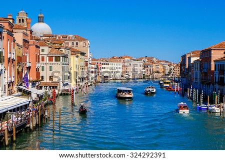 VENICE, ITALY - on MARCH 29, 2015. Old houses and gondola pier ashore Grand channel (Canal Grande). The grand channel is the main transport artery of Venice and its most known channel #324292391