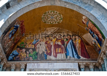 Venice, Italy: outer facade West, Mosaic of the St. Mark's Basilica. The arches of the four side portals show the story of the St. Mark's Relic and its transfer to Venice