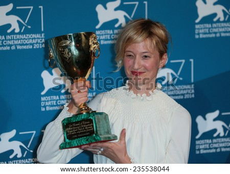 VENICE, ITALY - SEPTEMBER 06: Alba Rohrwacher with her Best Actress award during the award winners photocall  during the 71st Venice Film Festival on September 06, 2014 in Venice, Italy