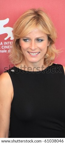 VENICE, ITALY - SEPTEMBER 04: Close-up of actress Karin Viard posing for photographers at 67th Venice Film Festival September 04, 2010 in Venice, Italy. - stock photo