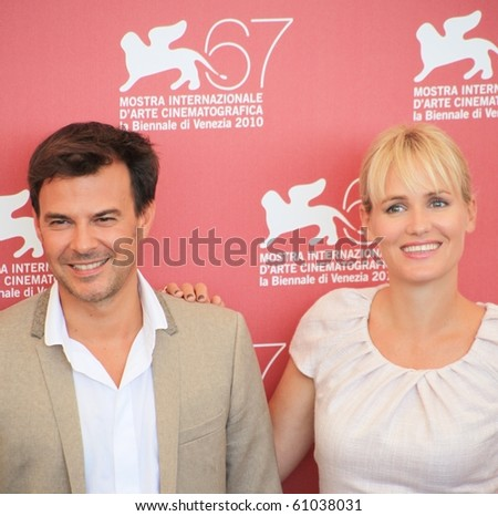 VENICE, ITALY - SEPTEMBER 04: Close-up of Francois Ozon and Judith Godreche pose for photographers at 67th Venice Film Festival September 04, 2010 in Venice, Italy.