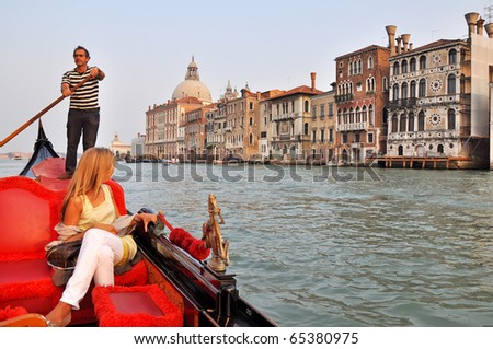VENICE, ITALY - 29 SEPTEMBER 2009: Gondolier rides gondola on the Grand Channel on September 29, 2009. The profession of gondolier is controlled by a guild, which issues a limited number of licenses. - stock photo